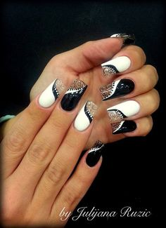 These black and white nails are beautiful. I would drop them shorter for me to be able to make a fist.