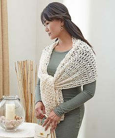 Easy V-stitches are perfect for showing off the beautiful oval sequins in this stunning yarn. This crocheted shawl is perfect for evening or to wear as a scarf any time of the day.