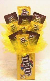 M's bouquet with base made of 4 theater size boxes of candy - genious!