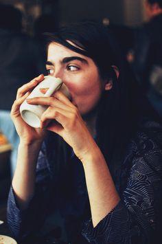 Girl drinking from coffee mug