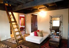 rustic cabin living room, ladder to loft, salvaged furniture, navaho rugs