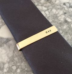 Gold Skinny Tie Clip with Custom Hand Stamping, Gold Tie Bar for Groomsmen/ Hand Stamped Tie Clip by PetiteTrinklets on Etsy https://www.etsy.com/listing/227641589/gold-skinny-tie-clip-with-custom-hand