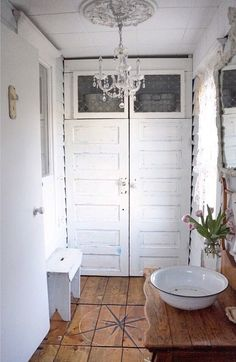 The Entrance's  | B Vintage, back entrance, chandelier, washbasin, white decor, home decor, wood floors, salvaged