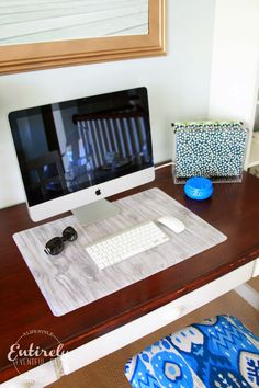 How to make a custom desk pad. Just a few steps... it looks so easy... and awesome. I have to try this! #homeoffice #diy @alybrooks