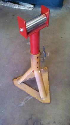 Roller Stand by am4X4 -- Homemade roller stand for a horizontal bandsaw fashioned from a surplus jackstand base, pipe, flat bar stock, and a floor jack's front roller. http://www.homemadetools.net/homemade-roller-stand-3