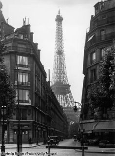 The Eiffel Tower seen from Parisian back streets, 1925.