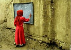 girl in red with blackboard Afghanistan