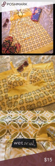 """Sundress Sunny colors and cool cotton fabric. No tag but measure is 13"""" flat at bust line. Will fit a small up to 26"""" bust. Shoulder to hem is 34"""". Wet Seal Dresses"""