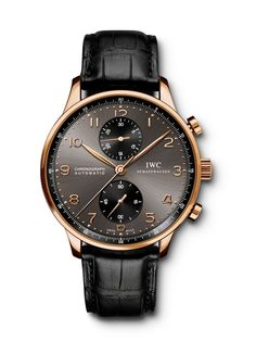 IWC 18k Rose Gold Portuguese Self-Winding Chrono-Automatic 18k rose gold 40.9mm case, slate dial with rose gold arabic numerals, self-winding, chronograph with black crocodile strap and 18k rose gold buckle. Available at London Jewelers!