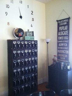 Cubbies!  Industrial Interior - Vintage filing cabinet, British subway sign, vintage candy machine