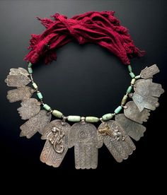Morocco ~ Tafilalet | Necklace; 13 silver khamsa, 16 amazonite beads and 32 small silver beads on wool and cotton cord | Est. 2'200 - 2'500€ ~ (June '14)