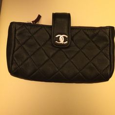 Authentic Chanel Black Quilted Coin Purse Authentic Chanel black coin purse. Side pocket will fit iPhone 4/5 (smaller version). Internal zip pocket. Pre-owned, very good condition. Made in France. CHANEL Bags Wallets