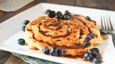 Fluffy Bisquick™ pancakes meet cinnamon buns with a brown-sugar & cinnamon swirl, for the yummiest breakfast treat ever.