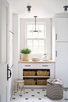 """""""I have one big 'no-no' with kitchen design, which is that you should never, ever see a toilet from the cooking space,"""" says Cindy. To eliminate the unappealing view, Cindy traded spaces—the bathroom adjacent to the kitchen became the laundry room and vice versa. Jami and Page placed a stackable washer and dryer in cabinetry where the bathtub once stood, and topped a folding station with a reader pick, Wilsonart's Truss Maple countertop. Gotham hexagonal floor tile from The Home Depot adds…"""