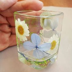 FLOWER SHOT GLASS by Mo Nelson - cast with Brilliant Resin and pressed flowers. What a beauty! See more at little-windows.com