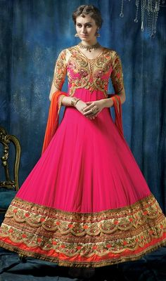 Exhibit the true essence of spring this pink embroidered georgette flared long Anakali suit. You can see some fascinating patterns accomplished with floral patch, lace, moti and resham work. #ElegantDesignOfAnarkaliChuridarSuit