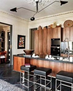 wood kitchen  ceiling-medallion-molding-architecture-character-contemporary-kitchen-clean-lines-black-floor-countertop-pretty-wood-cabinets