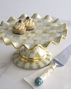 """Handcrafted dessert stand. Hand painted and fired with gold lustre accents. Terra cotta. 12""""Dia. x 6.25""""T. Hand wash. Each will vary due to the nature of handcrafting. Made in Aurora, NY, USA."""