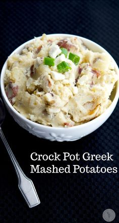 Greek Mashed Potatoes made in the crockpot with red bliss potatoes, scallions, oregano, lemon and Feta cheese make a tasty, easy side dish. #sides #mashedpotatoes #potatoes #crockpot #slowcooker