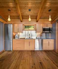 ***Shiny tile backsplash to bring in more light and make the room/kitchen seem larger***  Idaho 550 sq ft FabCab rustic-kitchen