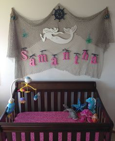 Nautical, Ocean, Under the Sea Nursery  - Crib - Netting with baby name, mermaid, etc.   Hang netting on hooks so it is easy to raise up when the baby gets older.