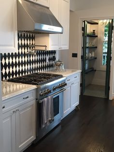 Black and white backsplash in this gorgeous old but new kitchen
