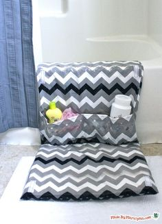 DIY Tubside Mat to give your knees a break and have easy access to toiletries....folds up when not in use. This is awesome!