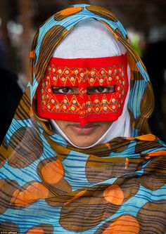 The masked women of Iran: Mothers pose in embroidered boreghehs