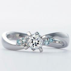 婚約指輪 WLD-80 流れるようなアームにしっかりとした爪が中央のダイヤモンドを目立たせ両脇のメレダイヤでゴージャス感UP。 存在感抜群のデザインです。素材は軽くて丈夫で耐久性に優れたパラス使用。