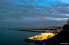 Dusk in Port Washington Wisconsin overlooking Lake Michigan Port Washington Wisconsin, Beautiful World, Beautiful Places, Lake Michigan, Dusk, Sunrise, River, Lighthouses, City
