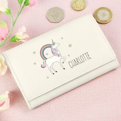 This gorgeous Personalised Unicorn Cream Purse is a stylish and sophisticated gift for her on any occasion.   The purse can be personalised with a name up to 12 characters in length. The name entered will appear in upper case.   The purse includes 3 card slots, change holder and ID compartment.  This purse is made from genuine leather.  Ideal for Birthdays, Mothers Day, Valentines Day, Wedding gift, Thank You presents, Christmas gifts
