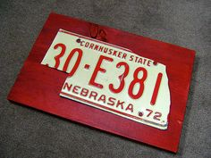 Cut your old license plate into shape of state & mount it. Cool art piece!