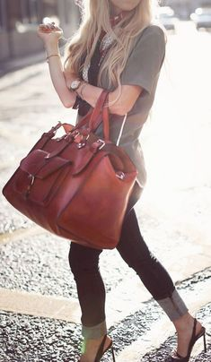 20 Looks with leather handbags.  Glamsugar.com This vintage-inspired leather duffel makes it easy to get carried away
