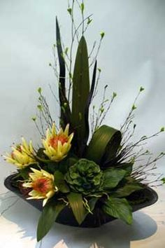 in a blk dish Gladiolus Arrangements, Tropical Flower Arrangements, Artificial Floral Arrangements, Ikebana Flower Arrangement, Deco Floral, Arte Floral, Faux Flowers, Silk Flowers, Yellow Flowers