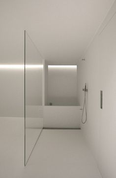 White bathroom, frameless glass