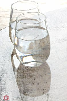 Digital Image of two glasses of water with a newsprint overlay.