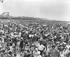 Coney Island beach, a summer day in 1946. The war was over, the weather was hot and over a million people crowded the Coney Island shore to cool off.