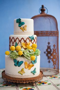 butterfly cake. {Love} me some butterflies! If I could go back I would have used them everywhere at our wedding and Tony and I would have released live ones or let the congregation release.