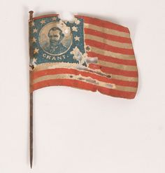"""Treated paper campaign flag/pin depicting Grant and Colfax with candidates images on either side, rare and desirable political memorabilia.  Approximately: 1 3/4\"""" x 1 1/2\"""".  Several small holes in field."""