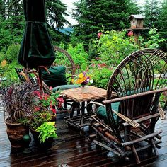 Garden Tour: The Everything Garden-Twig chairs on the deck offer one of several opportunities to relax and enjoy.