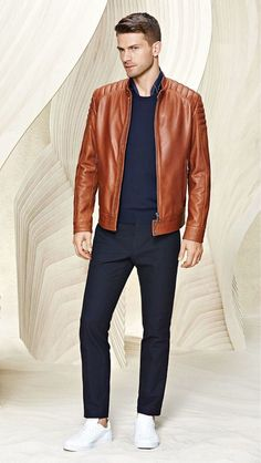 Pairing a tobacco leather bomber jacket with dark blue chinos is a comfortable option for running errands in the city. If you don't want to go all out formal, go for a pair of white leather low top sneakers.   Shop this look on Lookastic: https://lookastic.com/men/looks/bomber-jacket-crew-neck-sweater-chinos/17675   — Navy Silk Scarf  — Navy Crew-neck Sweater  — Tobacco Leather Bomber Jacket  — Navy Chinos  — White Leather Low Top Sneakers
