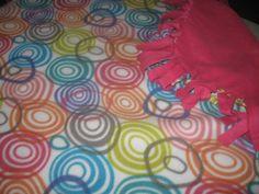 Pink and circles handmade fleece tie blanket on craftshowcase.net for $40.26