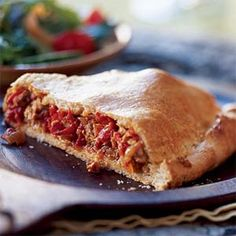 Empanada Gallega ....A large two-crusted savory pie from Galicia, the Spanish empanada is typically filled with fish or meat, red or green peppers, and lots of onion.