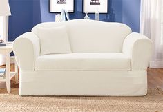 White slipcover....I think I would prefer this color but it makes me a little nervous to have a two year old around white upholstery!
