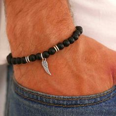Men's Beaded Bracelet - Men's Cuff Bracelet - Men's Bracelet - Men's Jewelry - Men's Gift - Husband Gift - Boyfriend Gift - Present For Men  The simple and beautiful bracelet combines Onyx gemstone beads and silver plated wing pendant. Gemstones strung together on a stretching silicone thread.  $32.5
