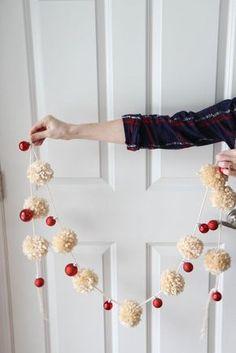 Yarn Pom-Pom & Ornament Garland - A fast one-hour garland made from yarn pom-poms & mini-ornaments. Use it to decorate a mantel, ledge - Christmas Yarn, Diy Christmas Garland, Diy Garland, Handmade Christmas, Christmas Decorations, Christmas Trees, Pom Pom Garland, Christmas Pom Pom Crafts, Christmas Lights