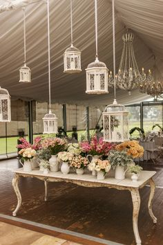 Eclectic Pitchers and Container after container of lovely blooms plus chandeliers and birdcages and everything else romantic you can fit in a tent!