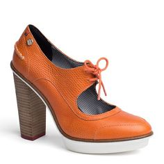 Orange leather sky high #pumps with a retro inspired lace-up and white rubber sole by Tommy Hilfige #colorblock