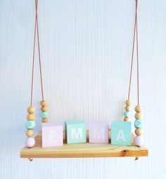 Kinderzimmer Ideen: Wandregal für das Kinderzimmer, Regalbrett mit Seilaufhängung und Holzkugeln in Pastellfarben / nursery furniture: hanging shelf for your kids' room, wooden rack with pastel beads made by Wooden-sweeties via DaWanda.com
