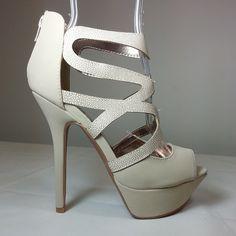 Nude peep toe platform pumps with crossing straps and stiletto heels #cutesyoriginals